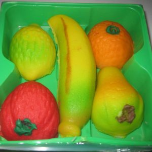 marzipan fruits in a green container
